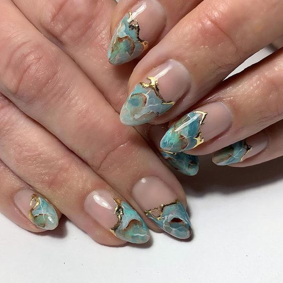 Mint green marble nail with gold