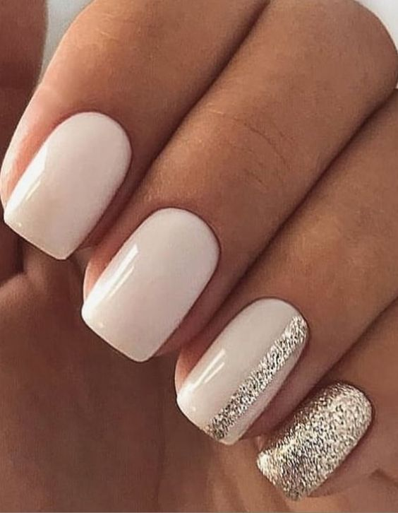 Short white nails with sparkles