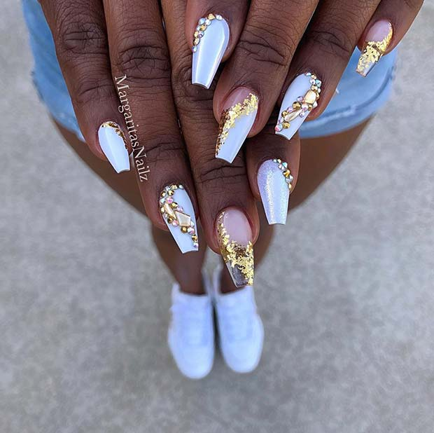 White nails with gold rhinestones