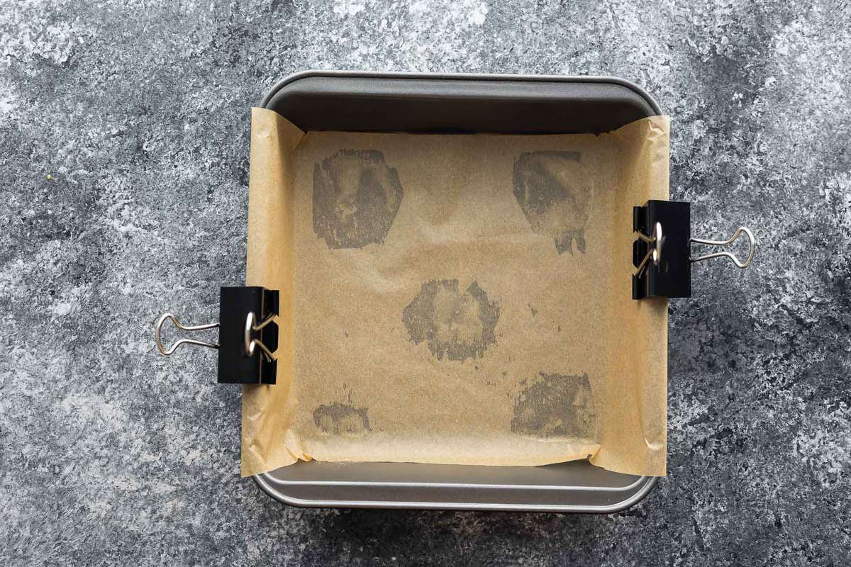 8 x 8 inch baking sheet covered with parchment paper and held in place