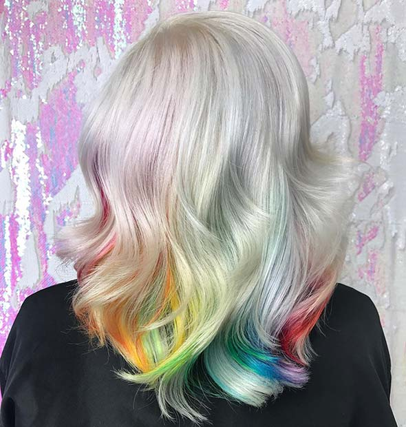 Light blonde hair with rainbow under lights