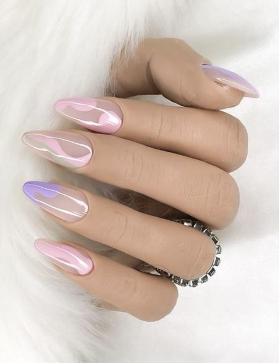 Trendy purple and pink pastel nails with swirls