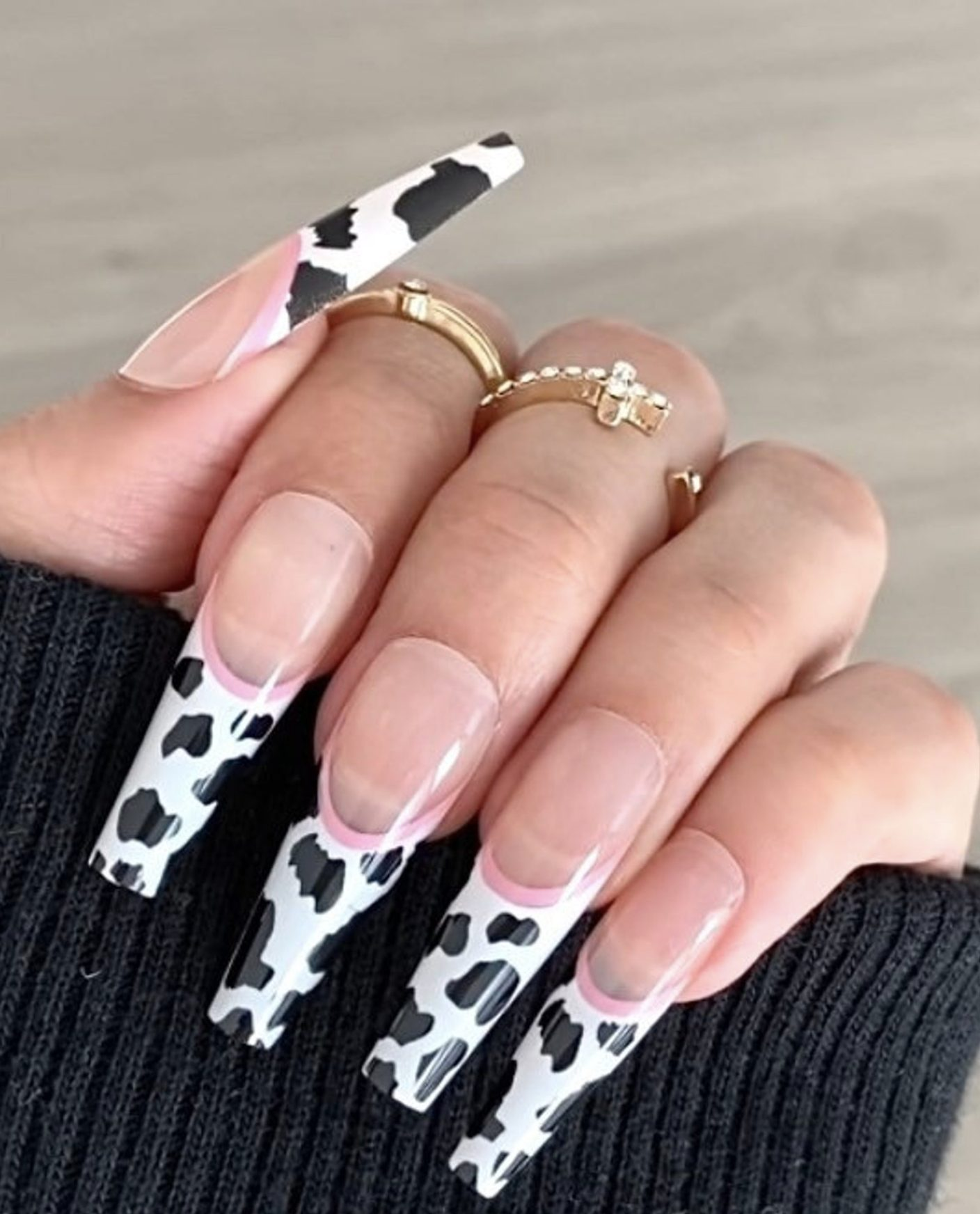 French tip nails with cow pattern in the shape of an acrylic coffin
