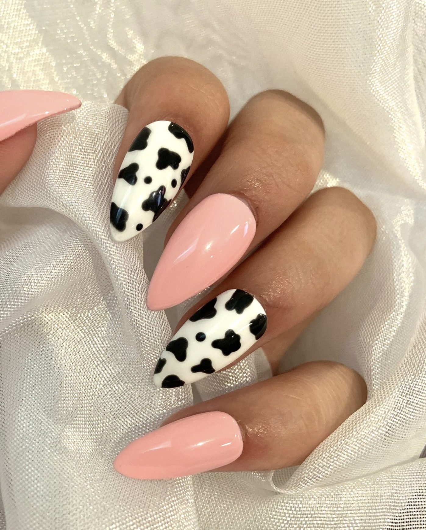 Pink and cow press on the nails