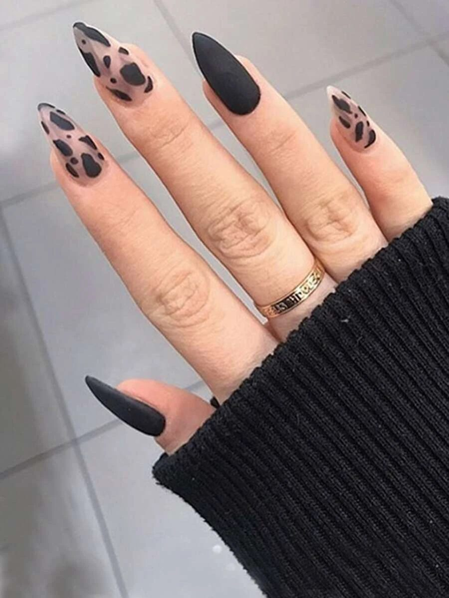 Matte black nails with a cow pattern