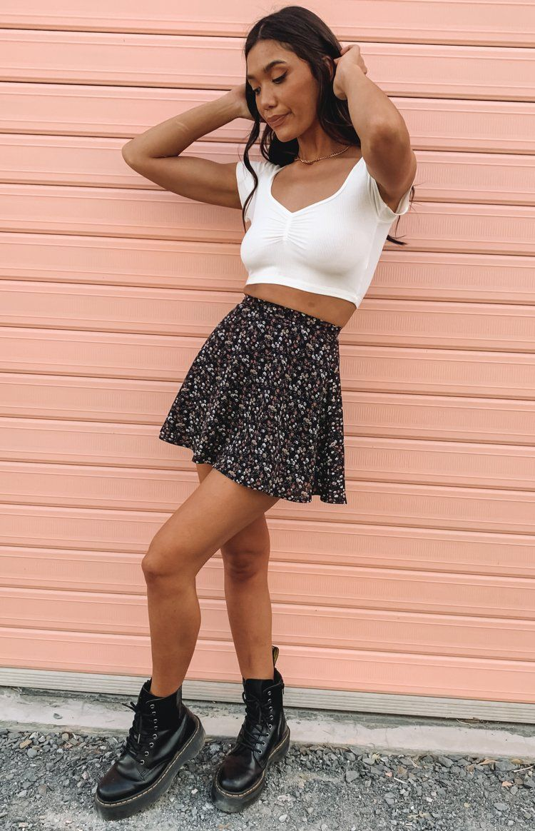 Nice black mini skirt with floral pattern and crop top
