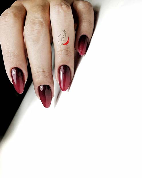Black to red ombre nails