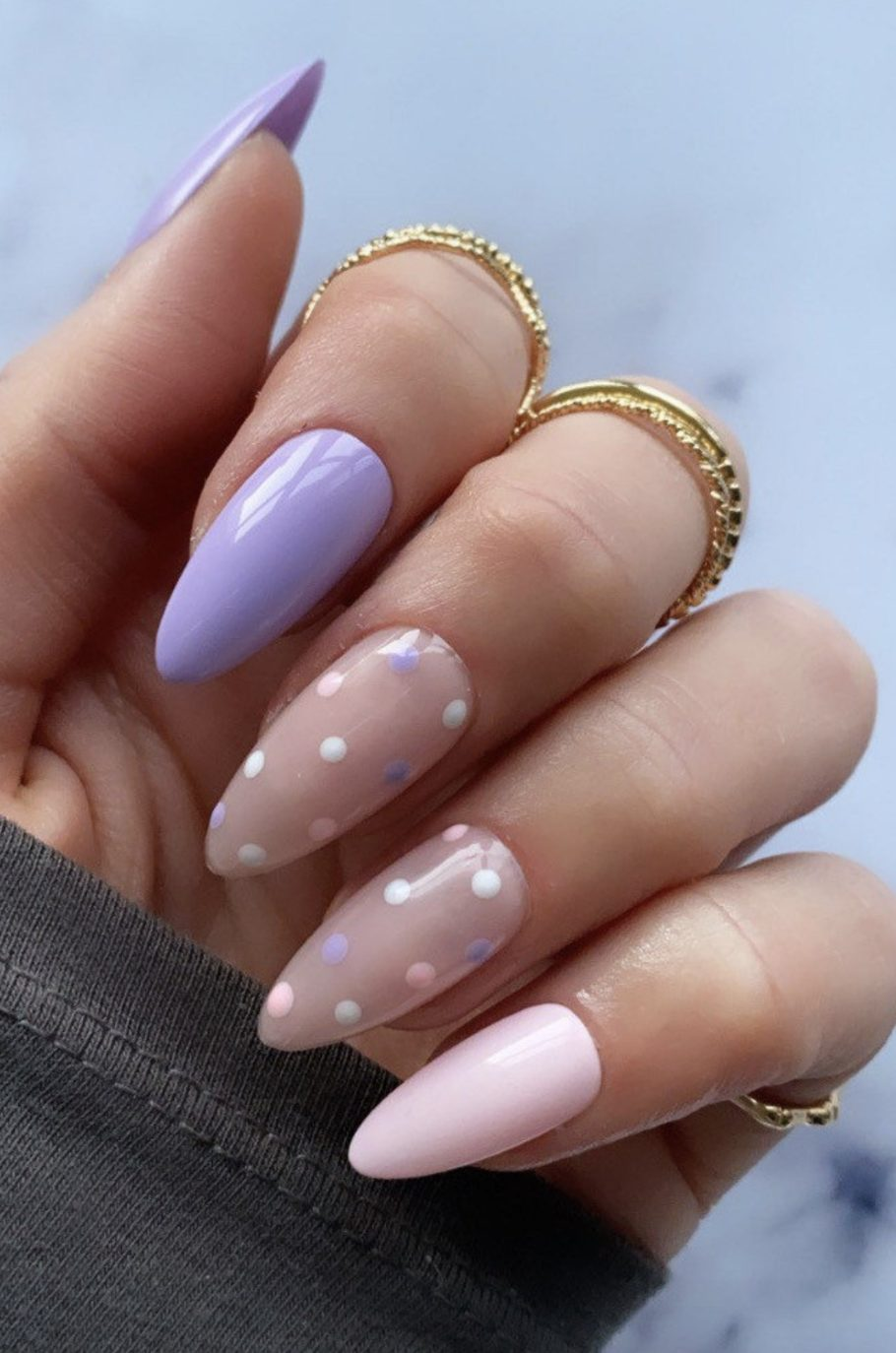 Pastel purple and pink nails with polka dots