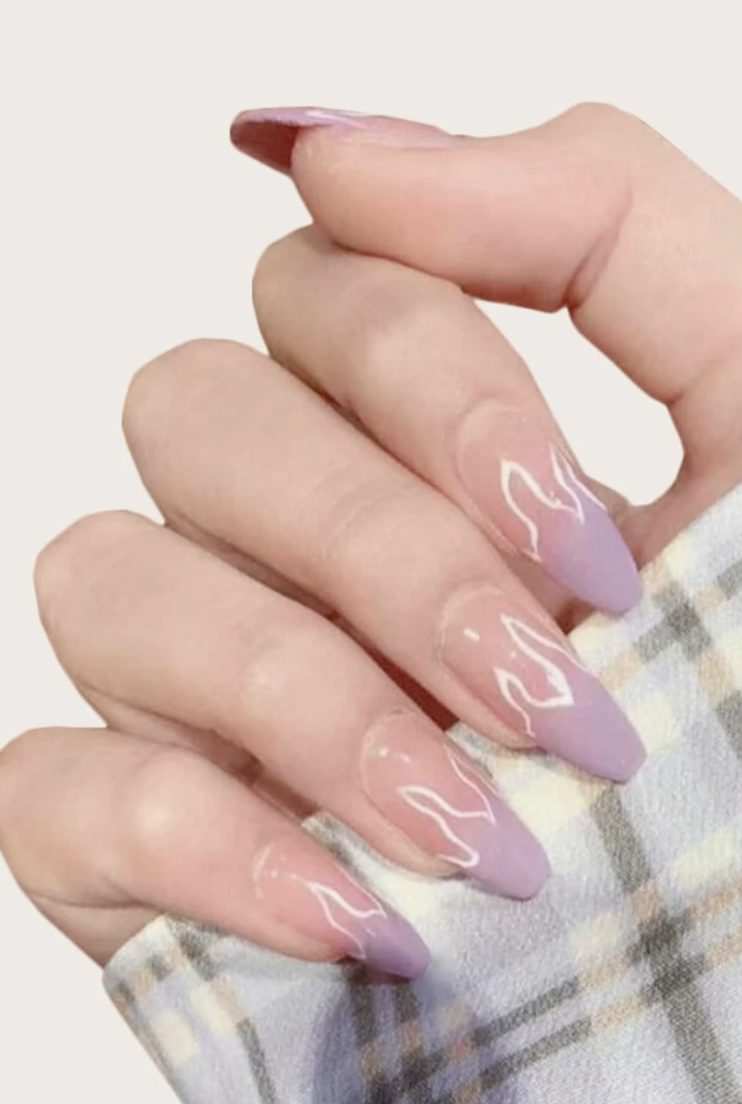 Matte pastel purple nails with flaming nail art