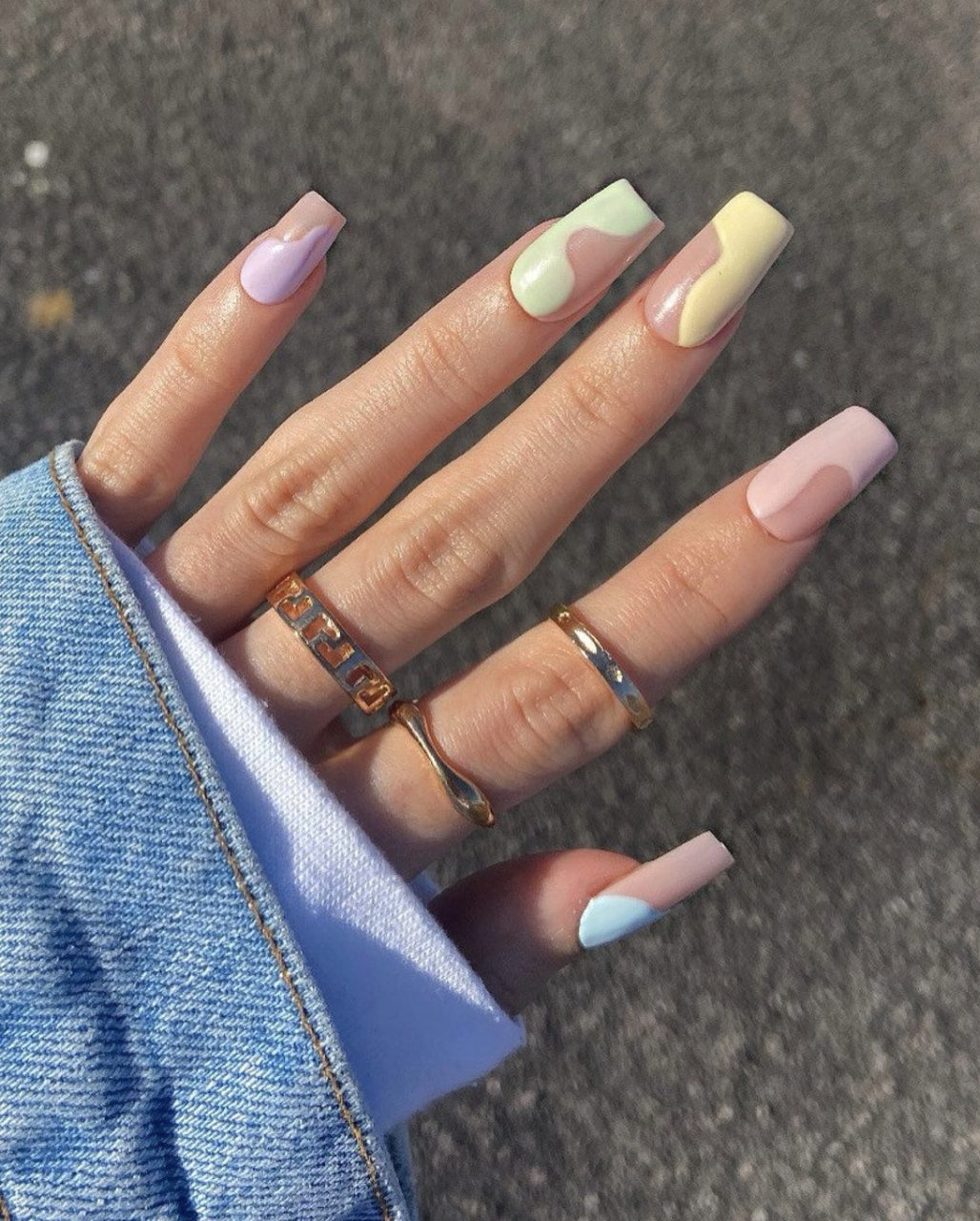 Trendy abstract pastel nails with swirls