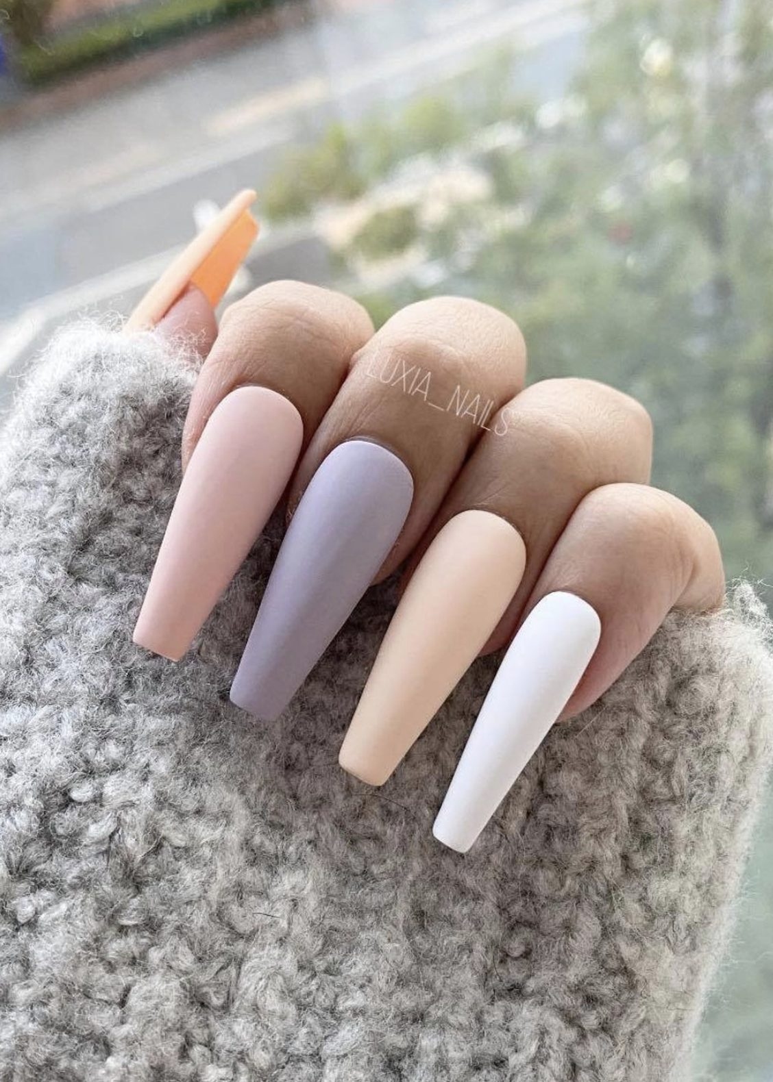 Matte pastel nails in the shape of an acrylic coffin