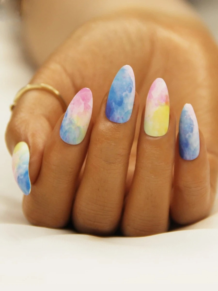 Associate lacquer nail art with blue, pink and yellow