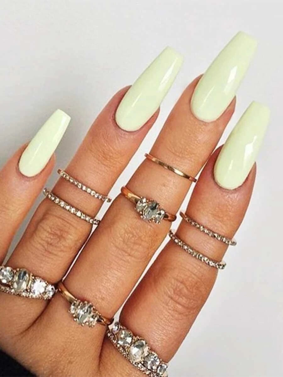 Pastel yellow acrylic coffin nails