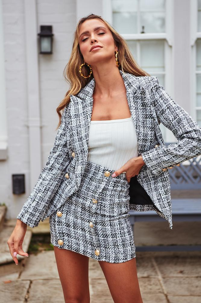 Matching checked blazer and rock outfit