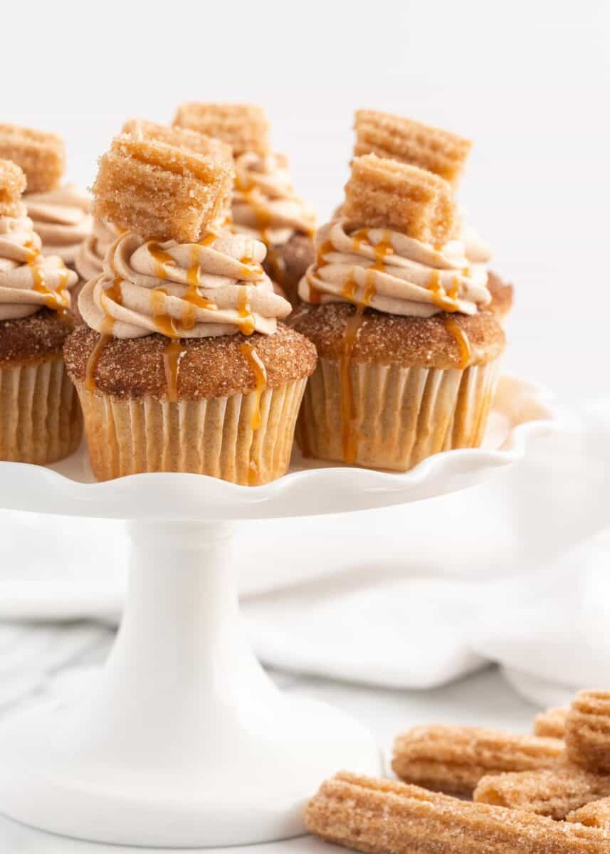 Churro cupcakes on a white plate