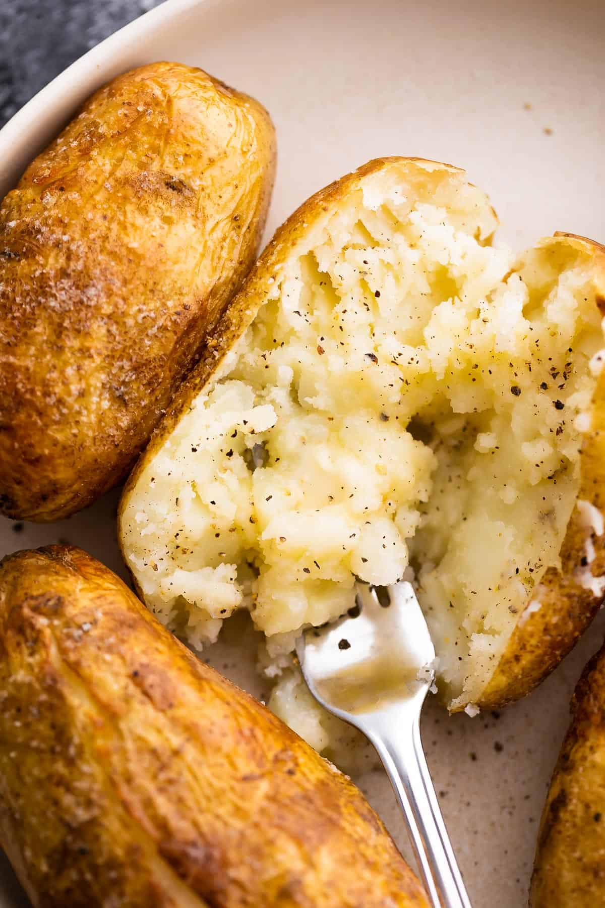 Close up the look of the soft, fluffy insides of a baked potato