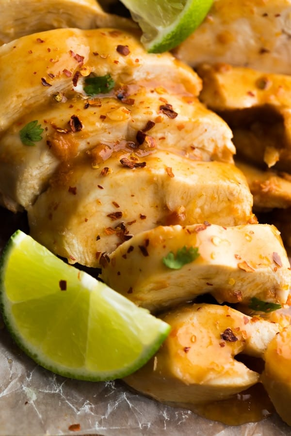 Close up of Instant Pot Chipotle Lime Chicken Breast sliced with lemon wedge