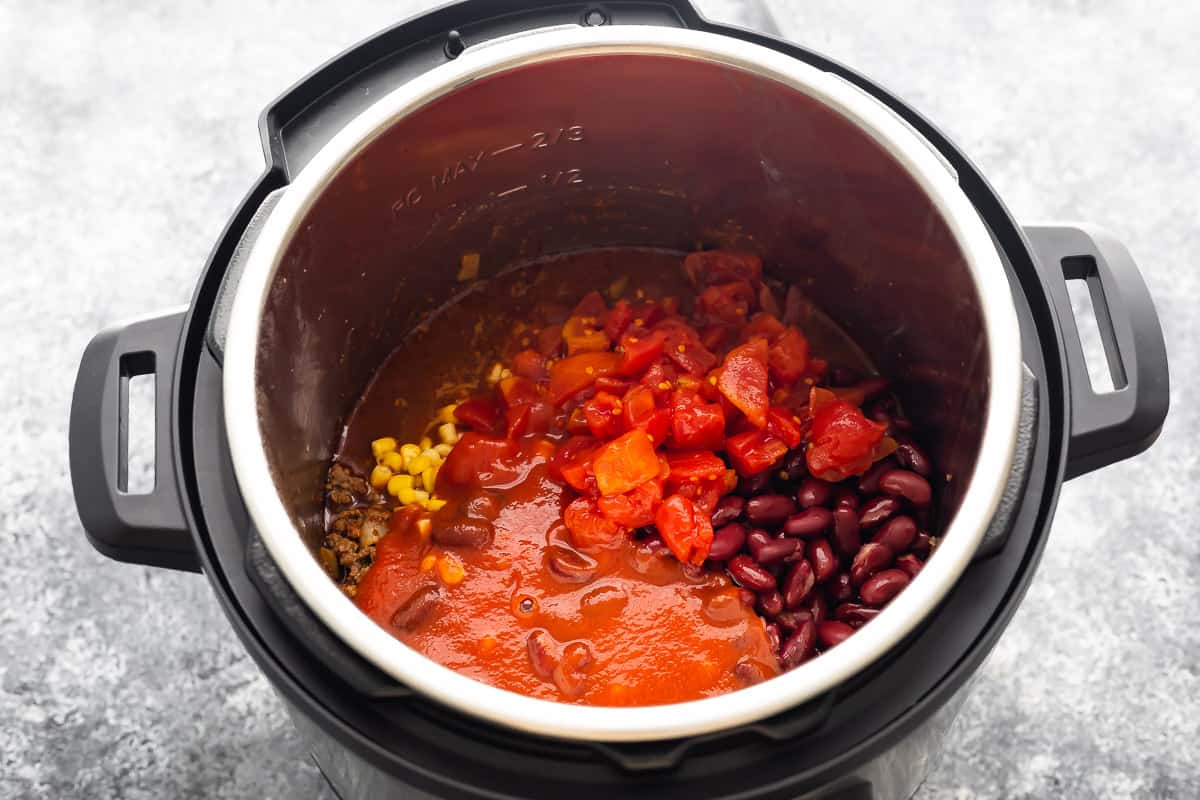 Necessary ingredients for making veal sweet peppers in a ready-made saucepan (before cooking)