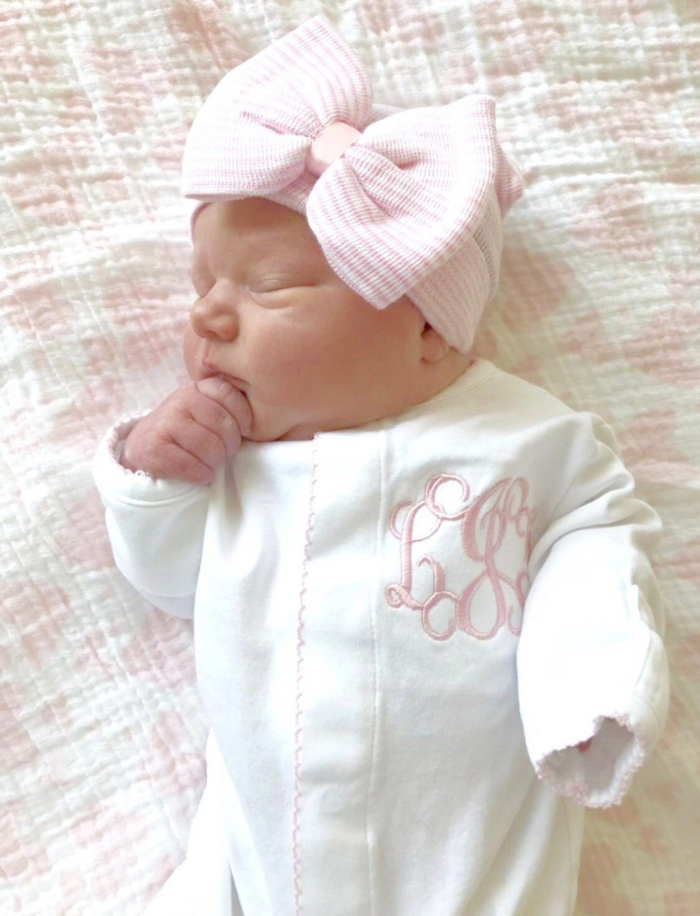 White and pink baby clothes for newborns with ribbons