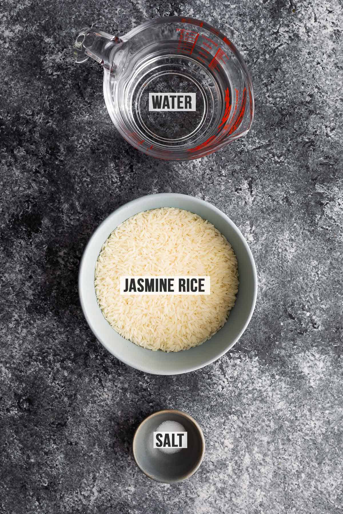 Overhead view of the ingredients needed to cook jasmine rice in a finished saucepan