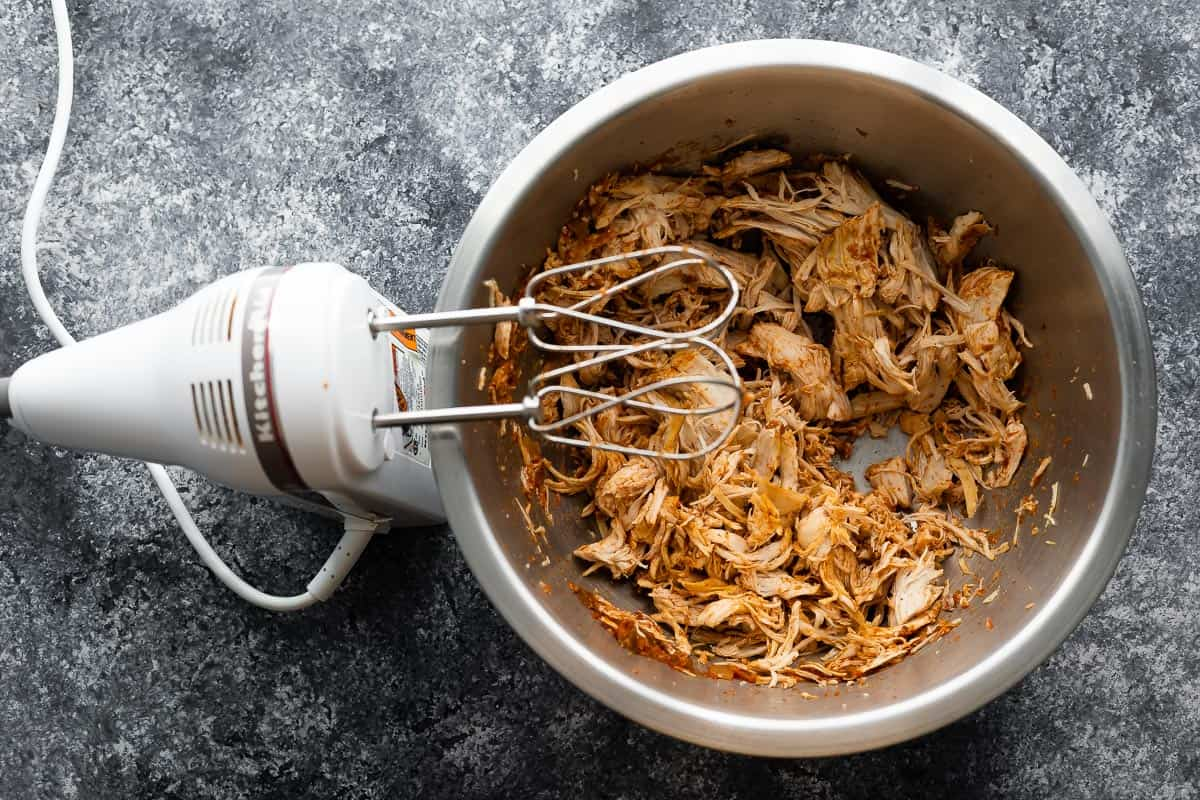 Salsa chicken, grated in a bowl with a hand mixer