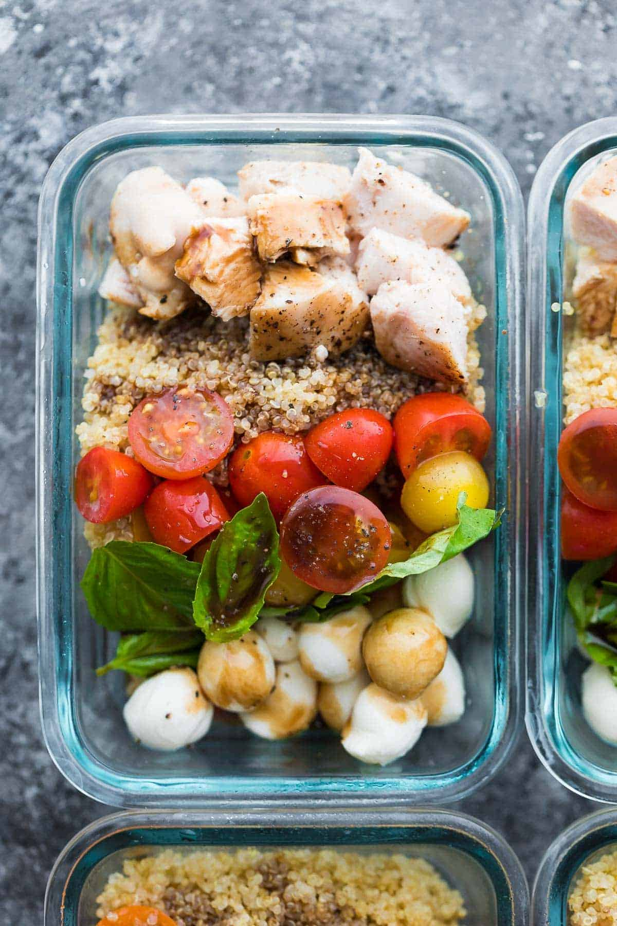 Overhead shot of Make Ahead Caprese Salad Preparation Bowls in Glass Containers