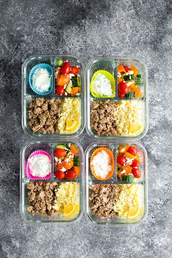 Overhead shot of four meal prep bowls with Greek turkey and salad