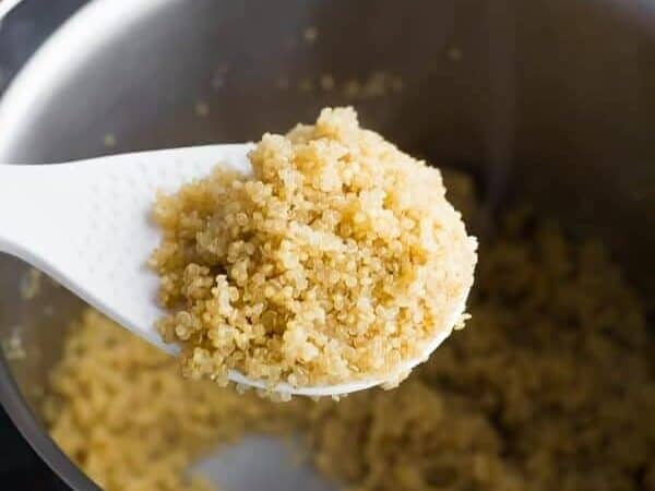 Use a spoon to put the quinoa in a large saucepan.