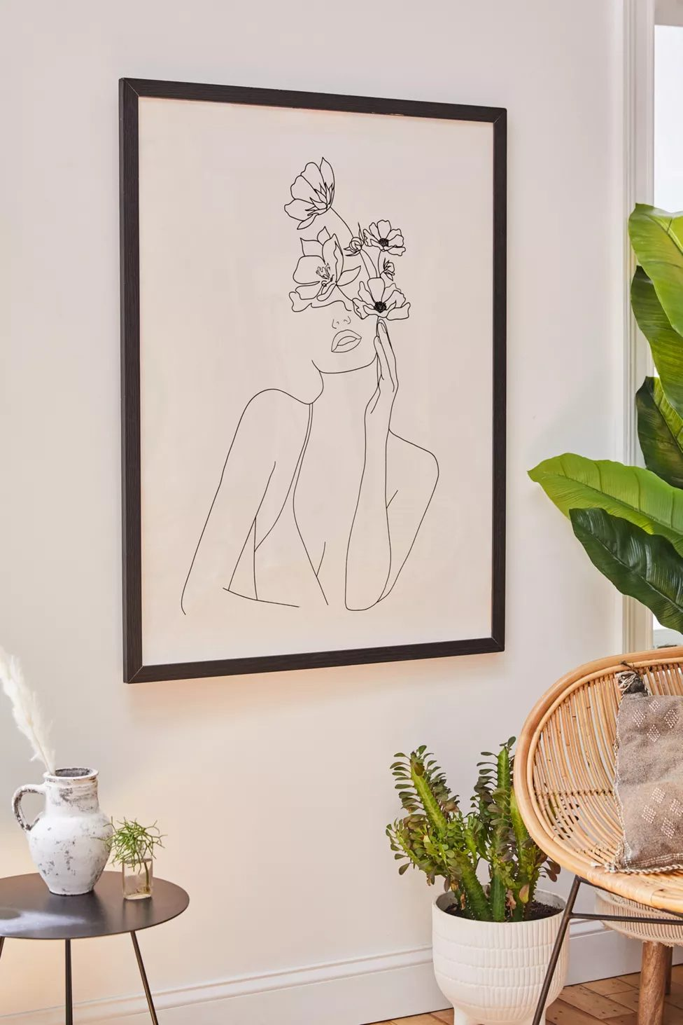 Abstract wall art with female figure and flowers