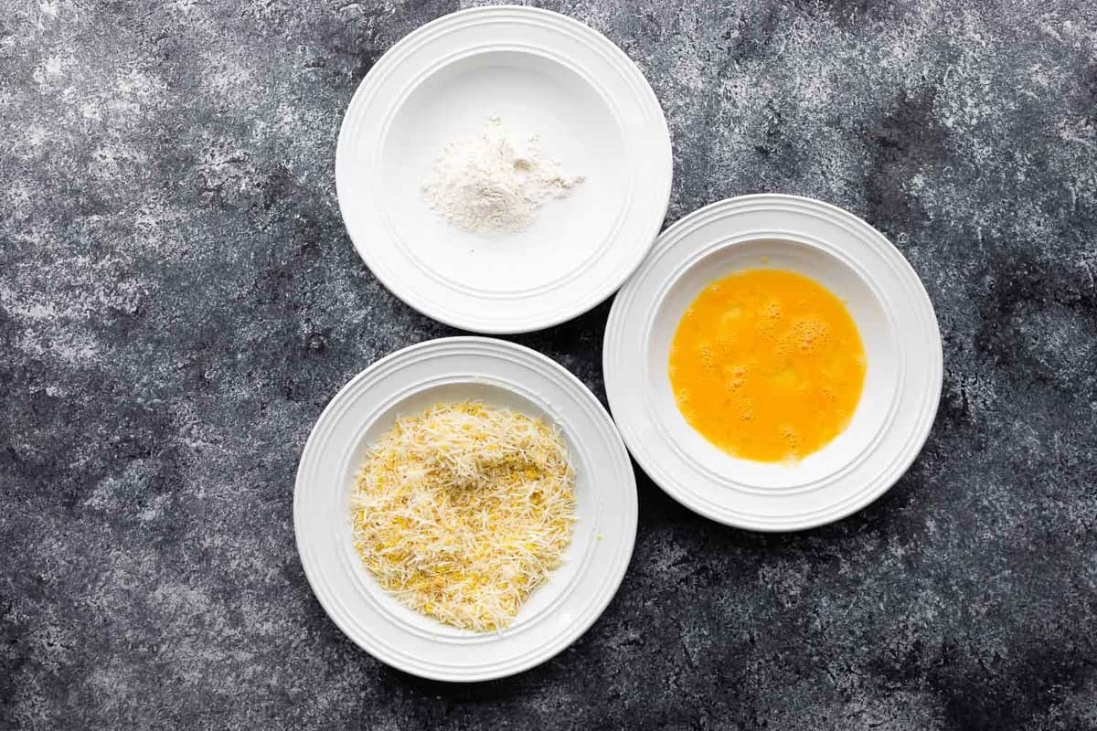 three bowls with flour, egg and panko