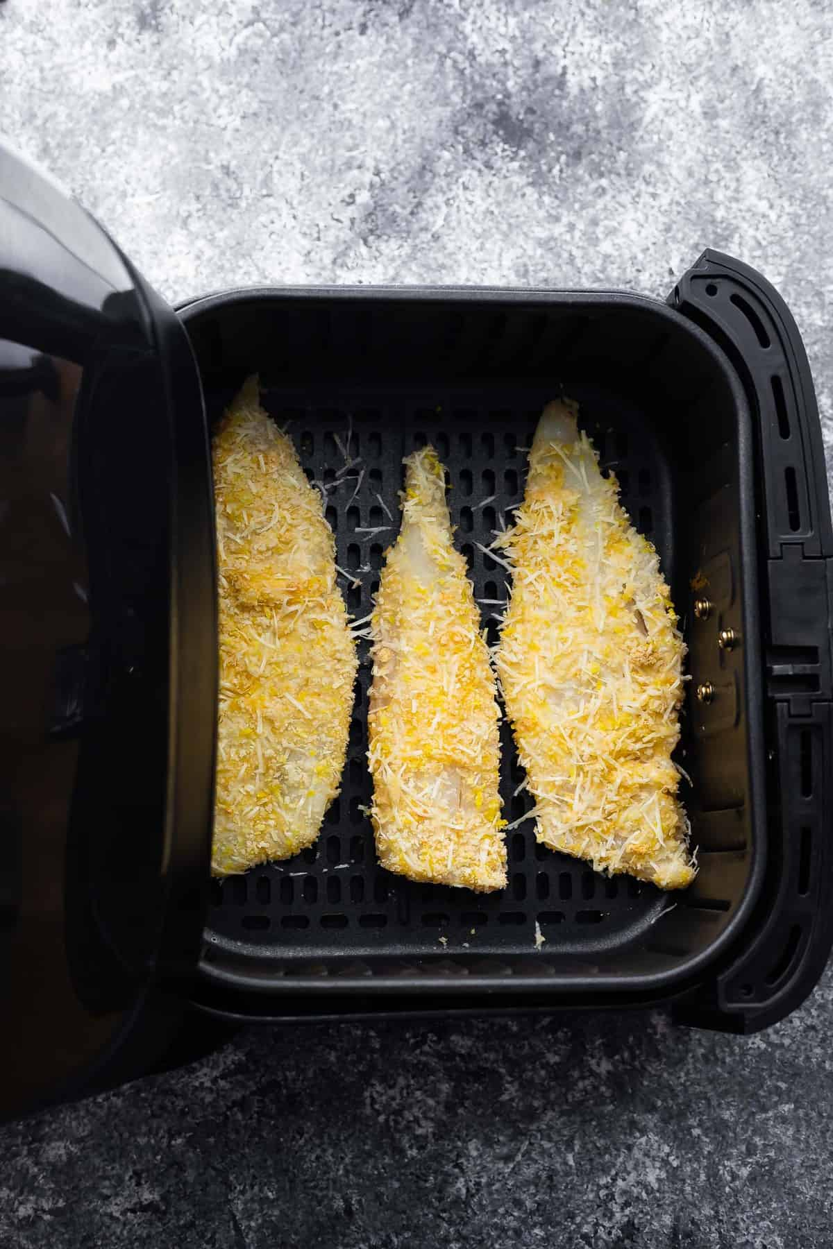 breaded fish in the deep fryer before cooking