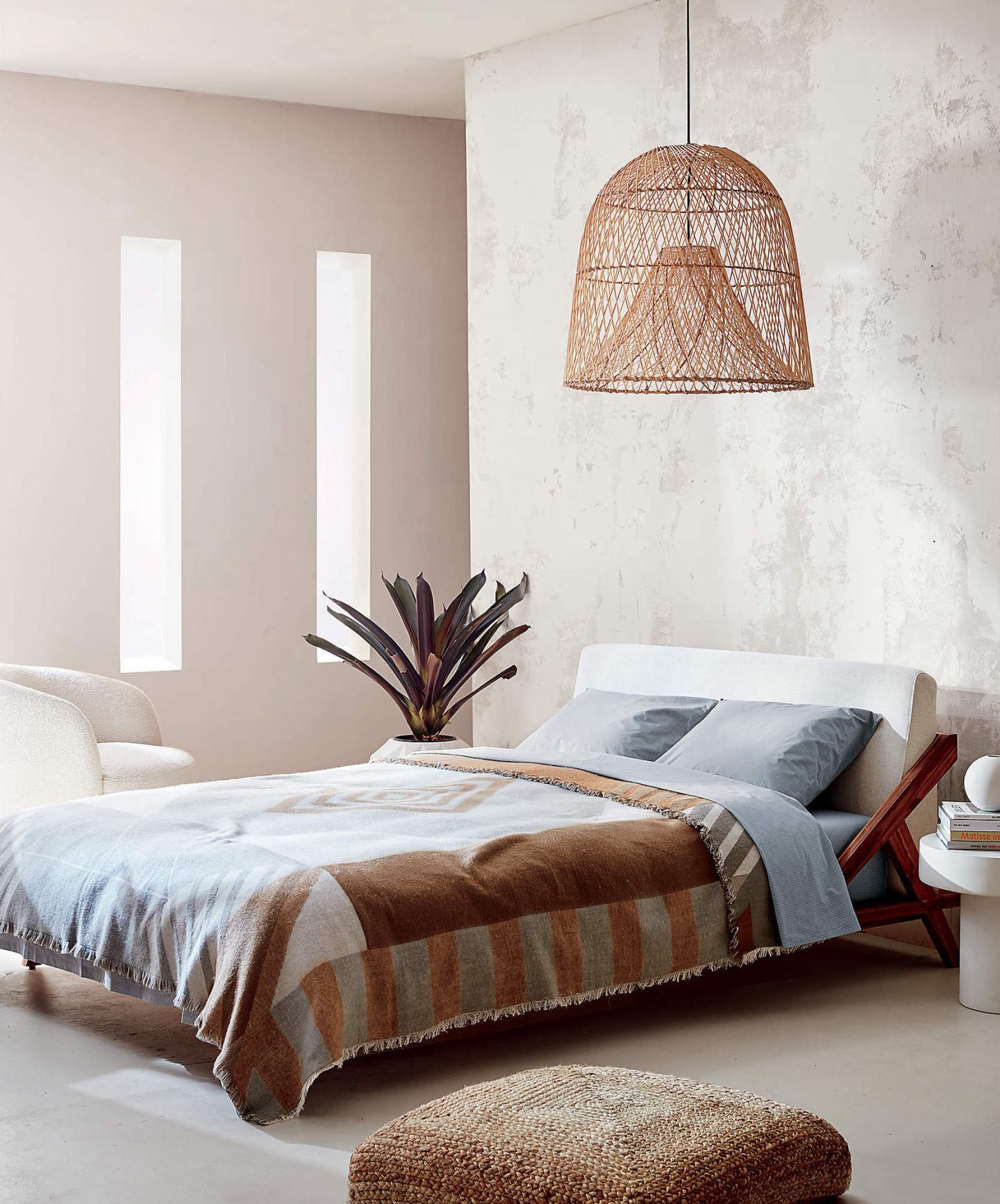 Rattan hanging lamp and low bed
