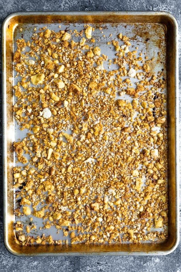 Crumbled tofu for the vegan spring roll bowl meal preparation in the sheet pan