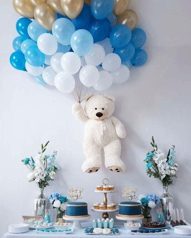 Ombre blue and gold balloons with baby shower toys