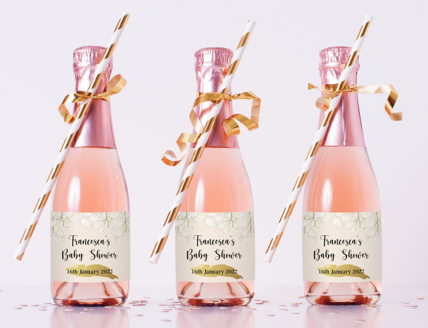 Custom pink baby shower favors in a champagne bottle