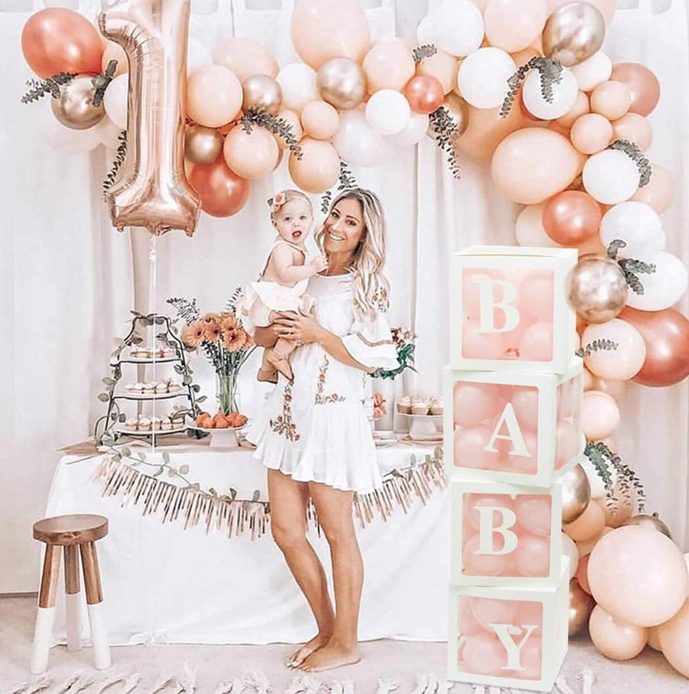 Baby shower decorations in pink and rose gold with balloons