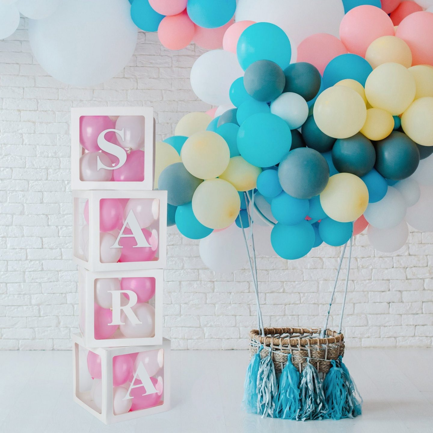 White transparent boxes for baby shower with balloons