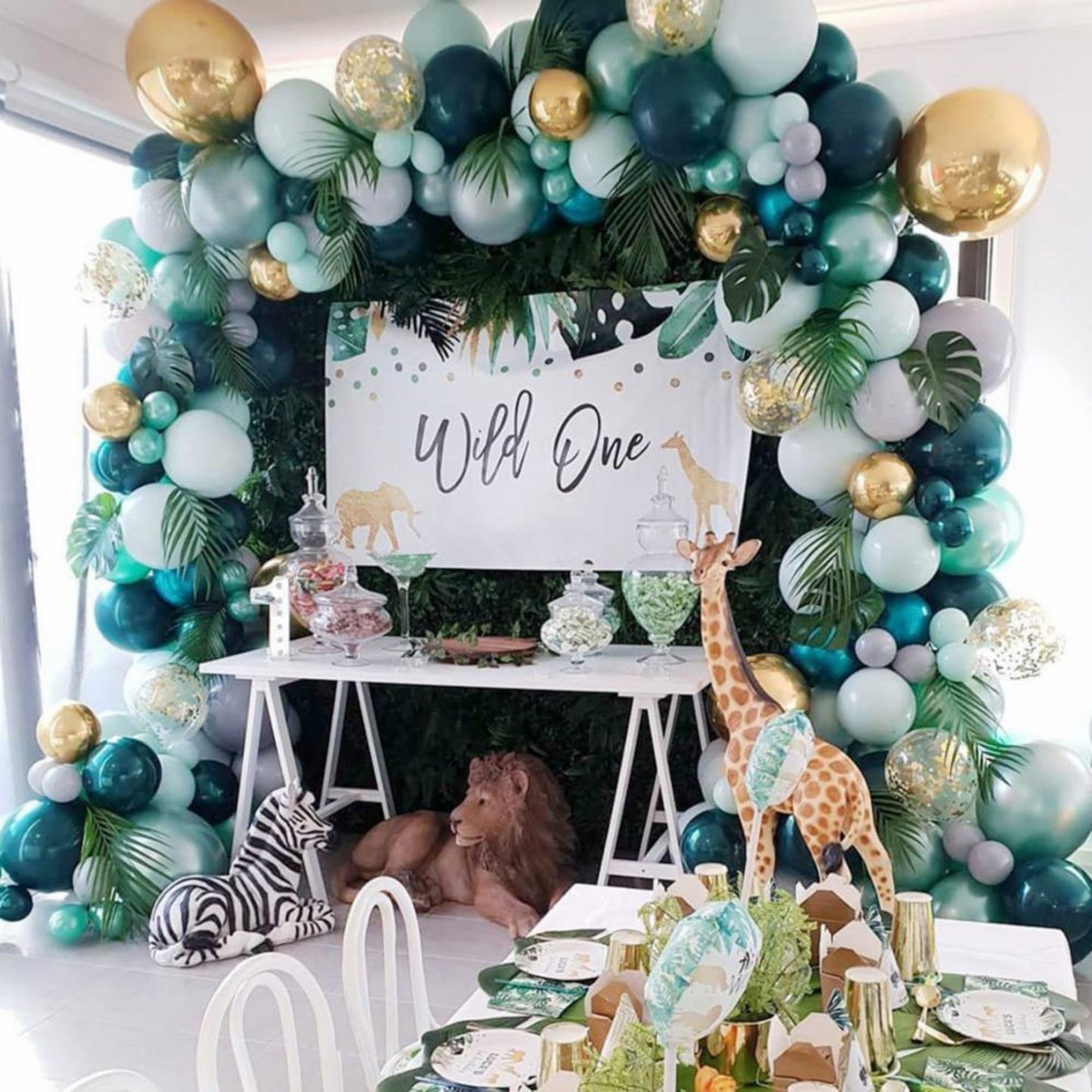 Safari birthday party decorations with green balloons