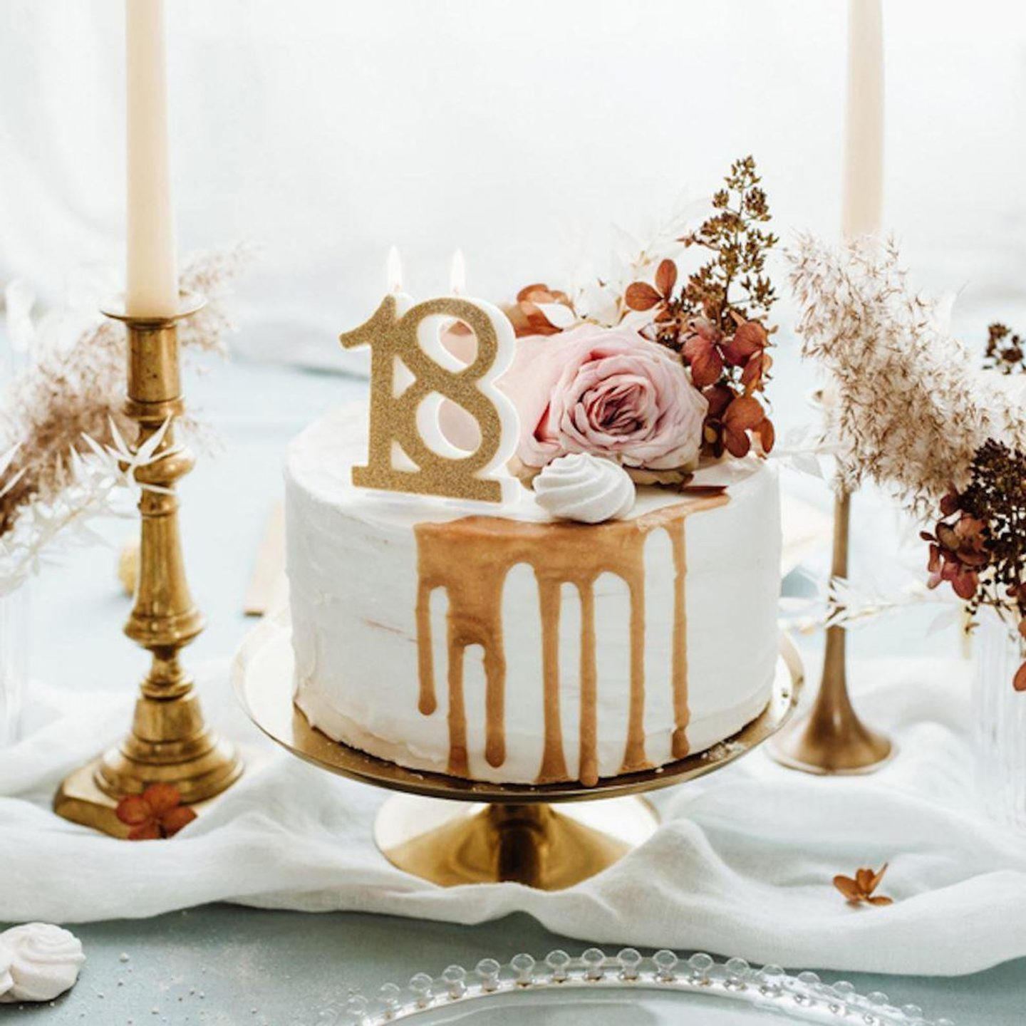 Candle decorated with gold cake