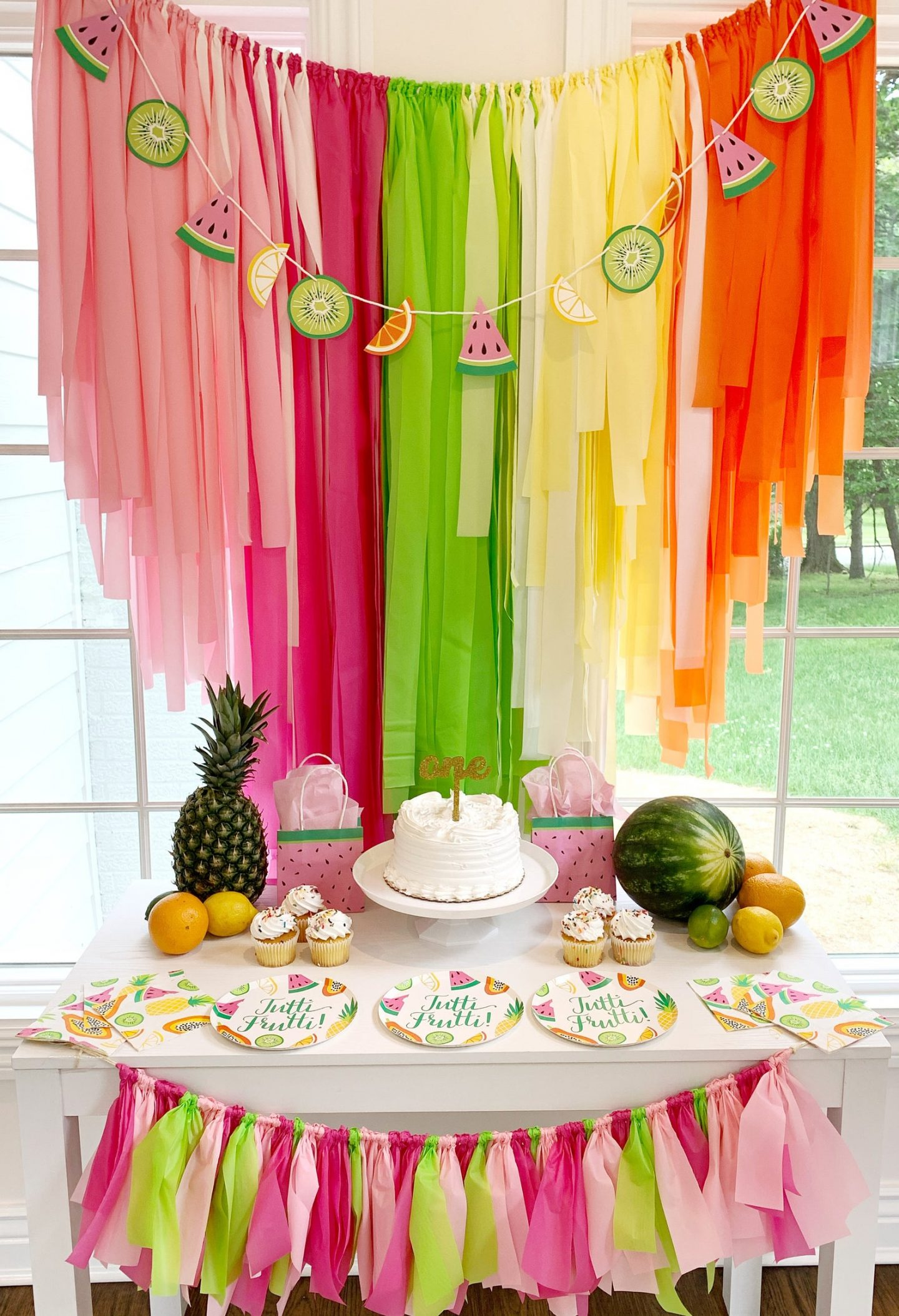 Birthday decoration with rainbow and watermelon fringes
