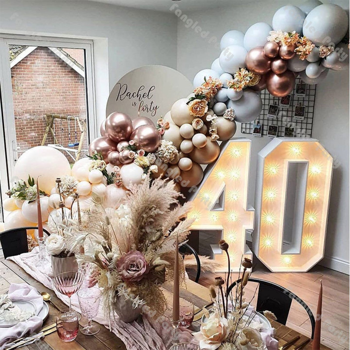 Rose gold birthday decoration with balloon garland and dried flowers for the 40th birthday