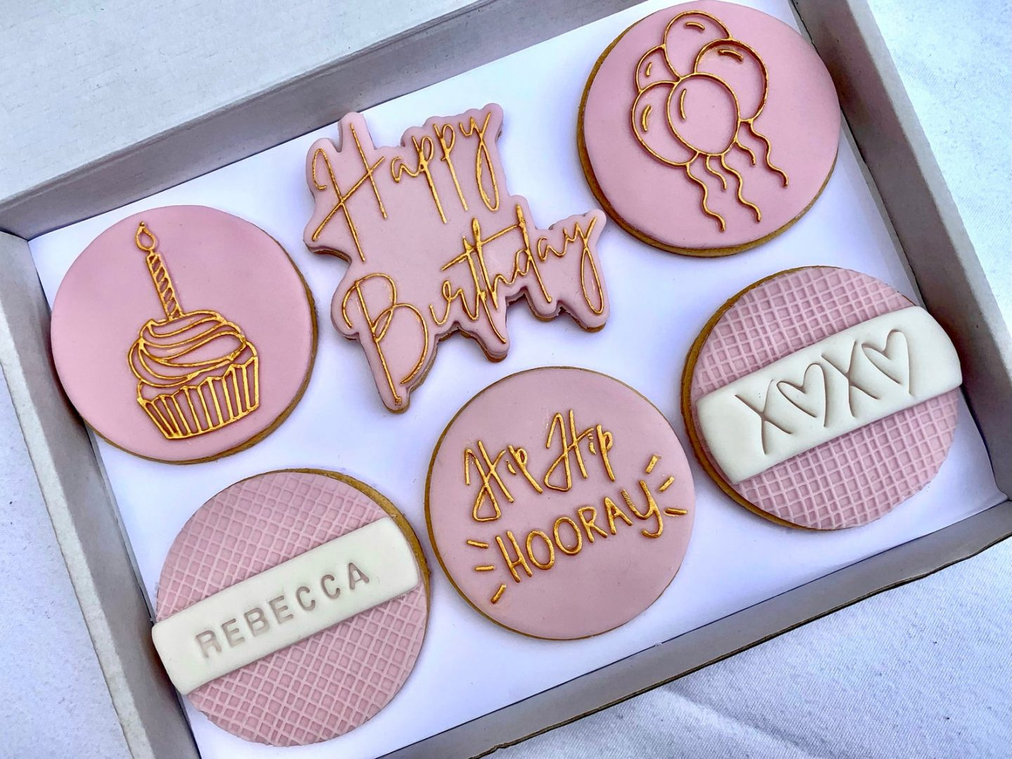 Pink decorated birthday cookies