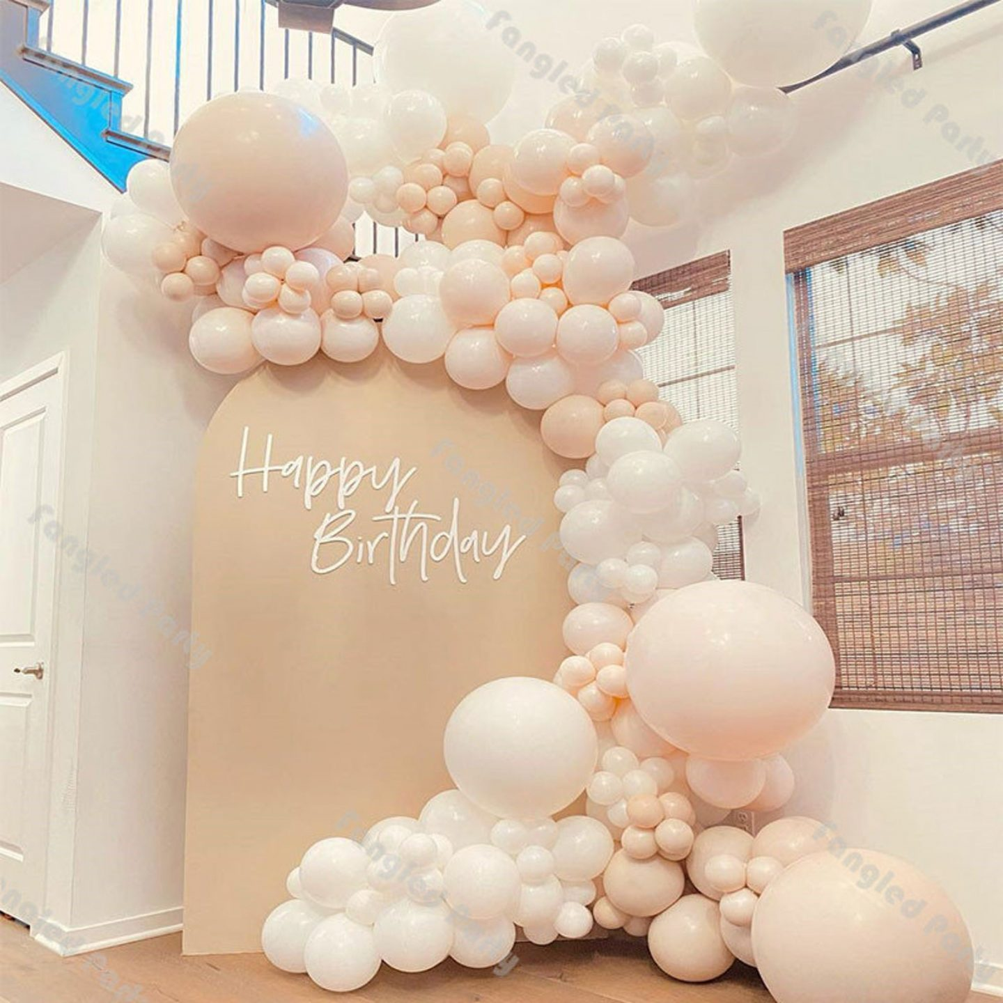White and light peach balloon garland bow for birthday parties