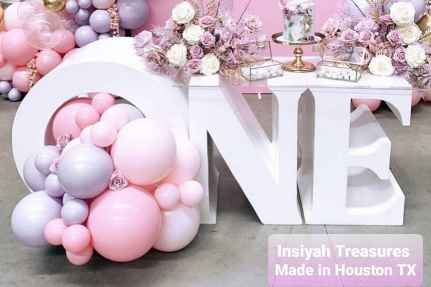 Ombre pink balloons and white table