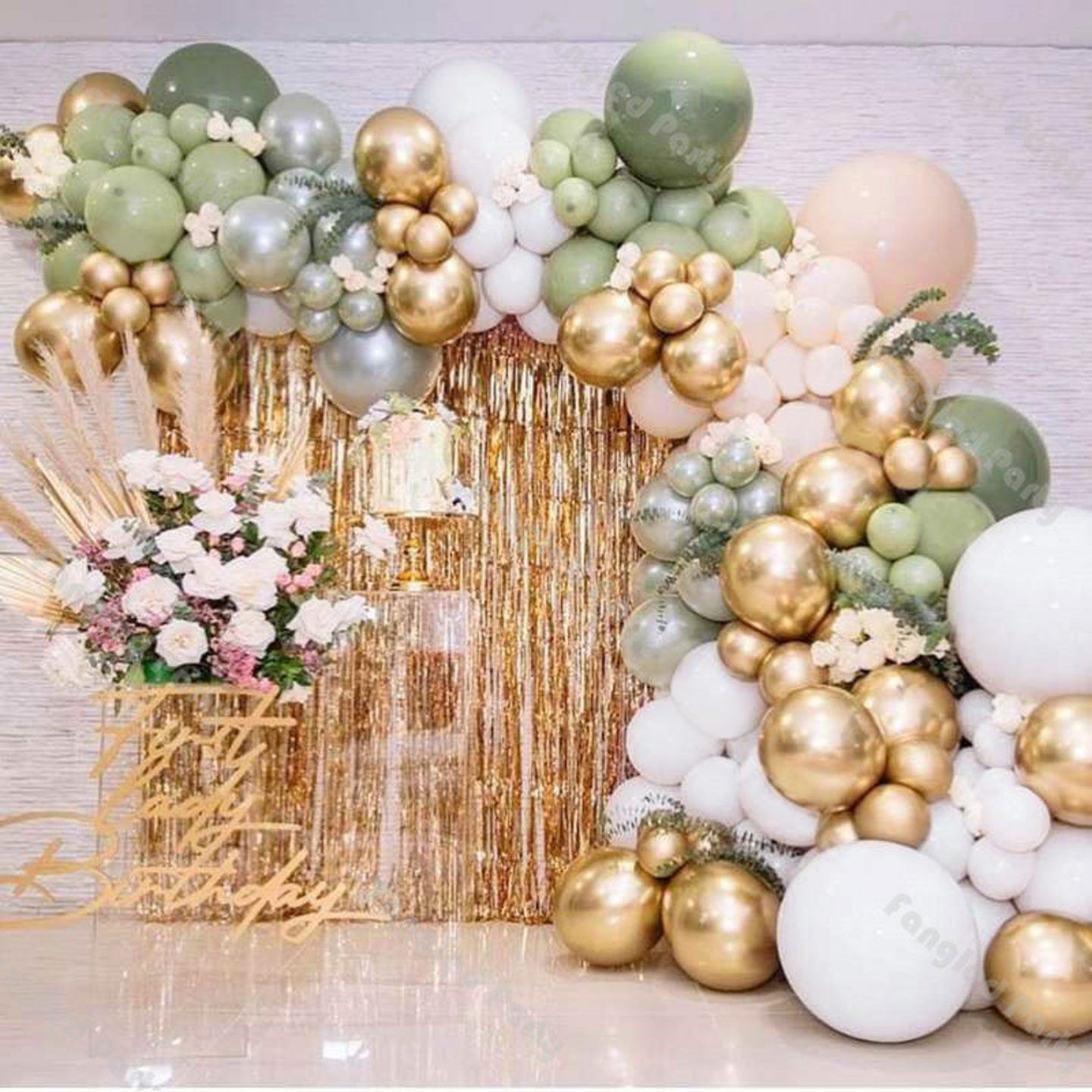 White, gold and sage green birthday balloons with a gold fringed curtain