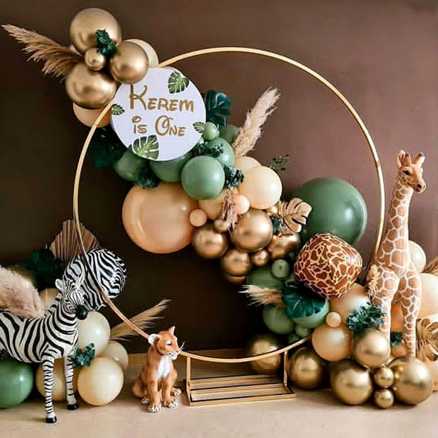 Balloon garland arch with safari motif in green and gold gold