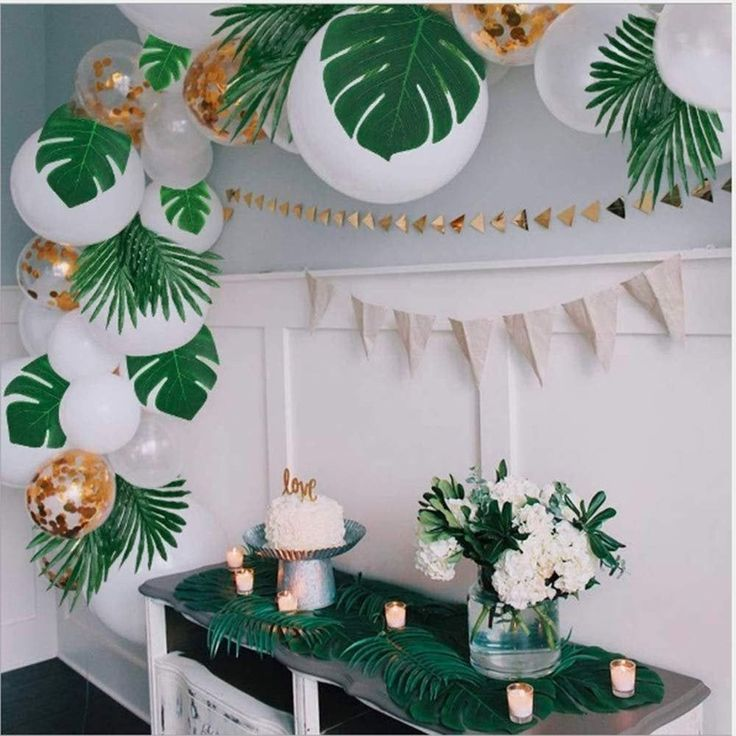 Safari birthday party decorations with monstera leaves