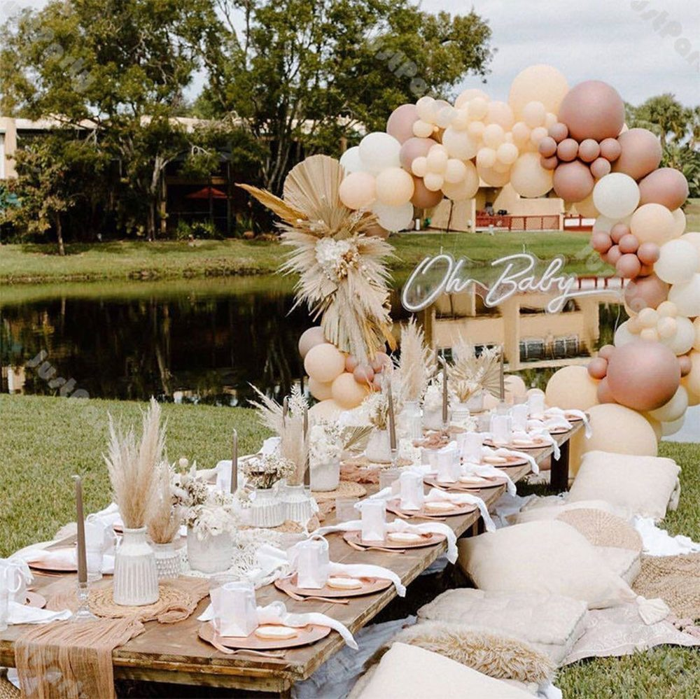 Balloon garland arch in cream and rose gold for parties