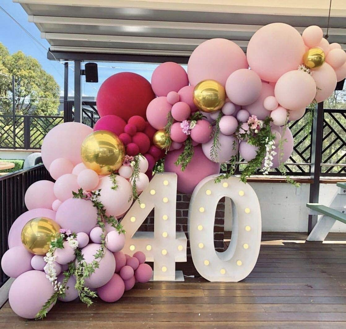 Ombre matte pink balloon garland with license plate