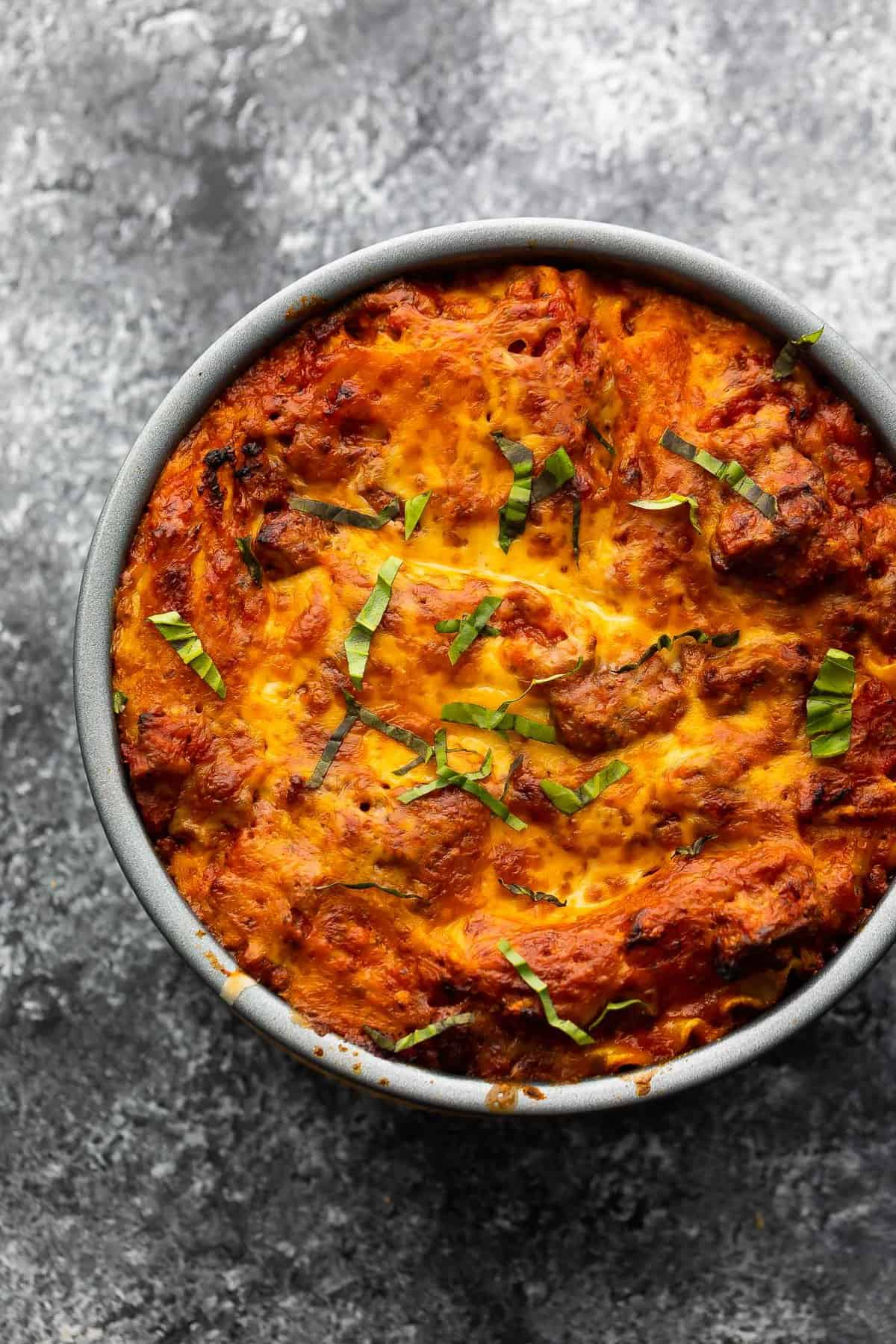 Lasagna baked in a round cake pan